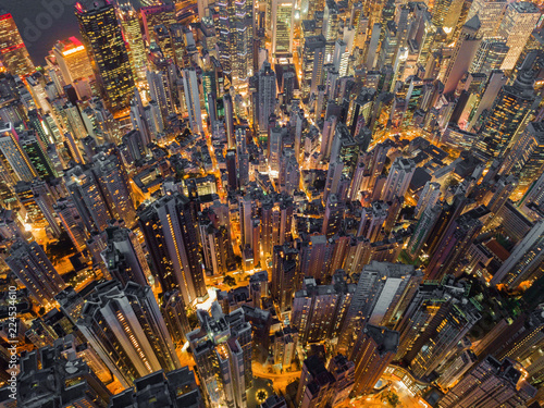 Photo Stands New York Aerial view of Hong Kong Downtown. Financial district and business centers in smart city, technology concept. Top view of skyscraper and high-rise buildings at night.