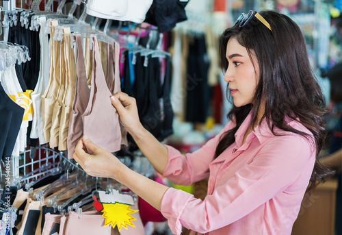 woman choosing and buying bra in shopping store - Buy this stock ... 64db837ad