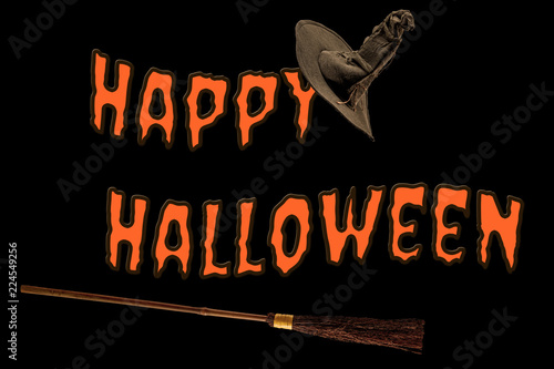 Happy Halloween, magic spell and flying broomstick concept with text frame by broom and witch or wizard hat on black background