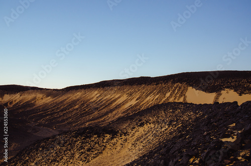 Black dunes and moutains on the Black desert in Egypt