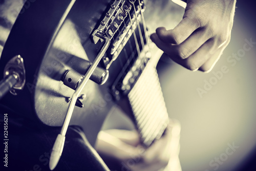 Spoed Foto op Canvas Grill / Barbecue Close up of man playing on electric guitar