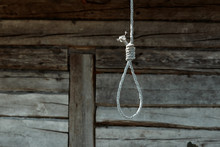 Hangman's Loop On A Wooden Wall Background. Creative Background, The Concept Of Despair, A Dead End, A Desperate Situation.