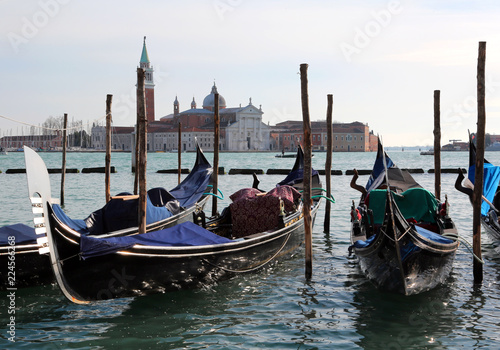 Spoed Foto op Canvas Gondolas Venice in Italy Some Gondolas and the Church of Saint George