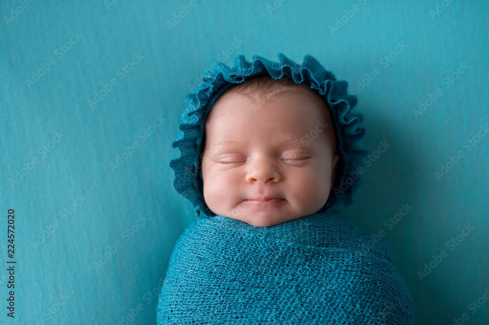 Fototapety, obrazy: Smiling Newborn Baby Girl Wearing a Turquoise Blue Bonnet