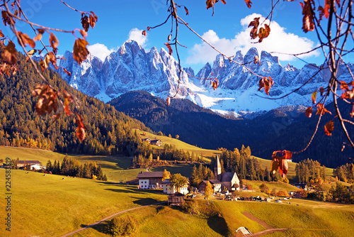 Magical autumn landscape with a church in the valley of Santa Magdalena, Italy, Europe, Dolomites