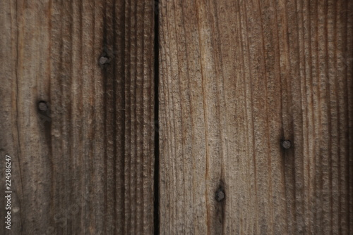 Tuinposter Hout old wood panel wall vertical pattern with rusty nail