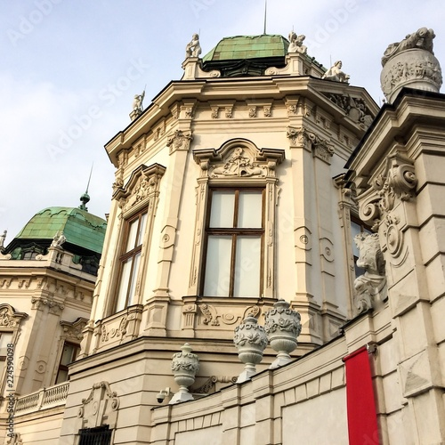 Foto op Aluminium Oude gebouw Historical building, building with a lot of decorative elements, red cloth, cloudy sky