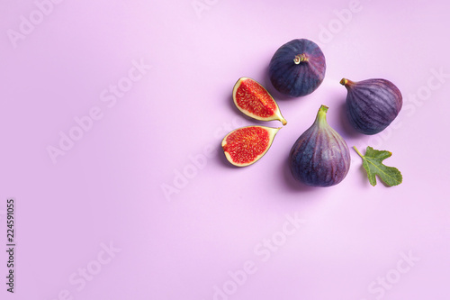 Carta da parati Fresh ripe figs on light background, top view. Space for text