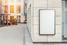 Blank Vertical Outdoor Banner At Bright Modern Building Wall, 3d Rendering.