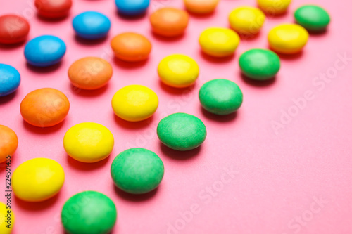 Tasty glazed candies on color background, closeup