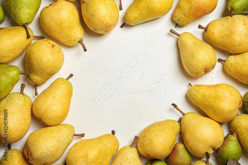 Flat lay composition with fresh ripe pears and space for text on white background