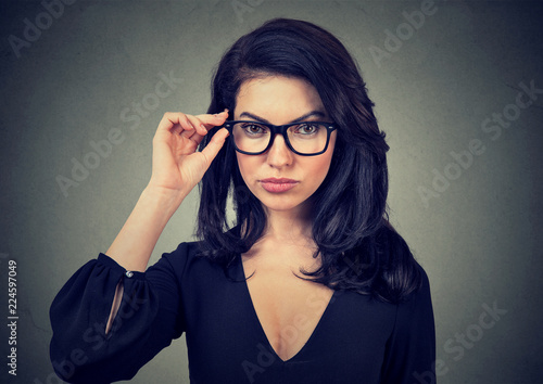 Elegant woman wearing trendy eyeglasses Slika na platnu