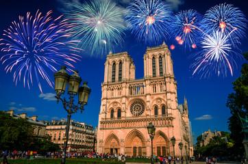 Famous cathedral Notre Dame de Paris with fireworks in Paris, France.