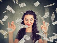 Woman Meditating Under Money Rain