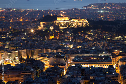 Illuminated Acropolis in Athens, Greece at dusk