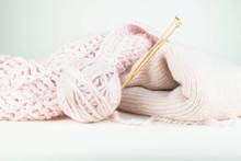 Pale Pink Wool Knitting Objects.
