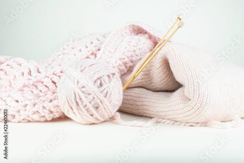 Fotografie, Obraz  Pale pink wool knitting objects.