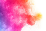 Fototapeta Tęcza - abstract powder splatted background. Colorful powder explosion on white background. Colored cloud. Colorful dust explode. Paint Holi.