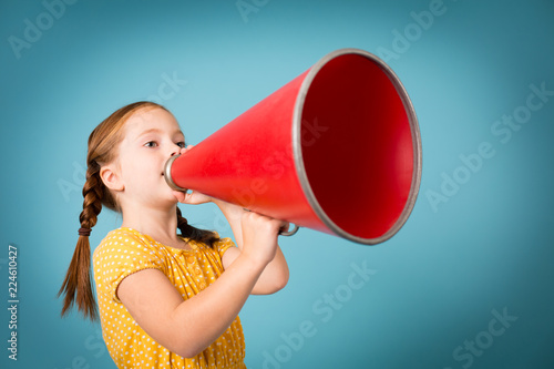 Girl Announcing with Megaphone, Isolated on Teal Canvas Print