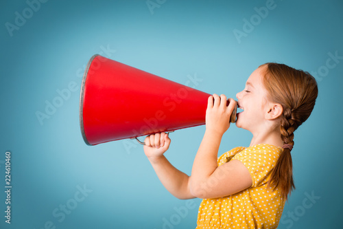 Girl Announcing with Megaphone, Isolated on Teal Wallpaper Mural