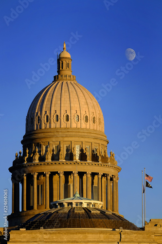 Fotografie, Obraz  Idaho State Capitol Building Government Dome Laws Legal Moon Sky Flags