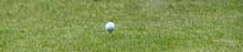 White Golf Ball On A Tee Banne...