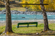 Swing For Relaxing On The Banks Of The River For Solitude With Nature