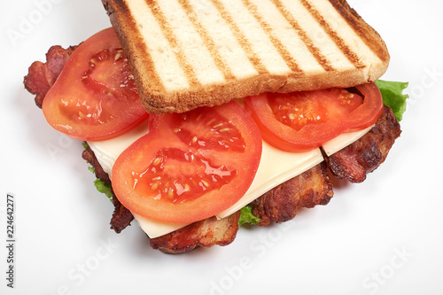 fresh sandwich close up with vegetables and meat isolated on white background