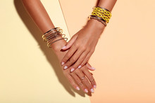 Female Hands With Bracelets An...