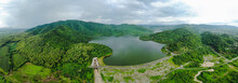 Aerial View Panorama Dam With Road And River In The Mountain