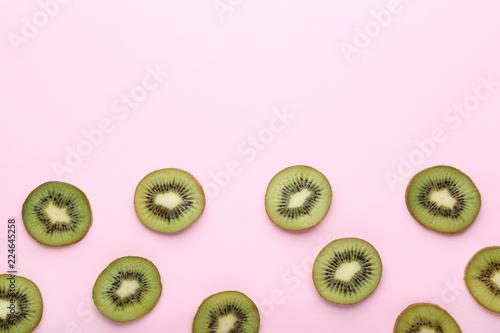 Fotografie, Obraz  Sliced kiwi fruits on pink background
