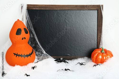 Orange halloween pumpkins with black frame and spiders