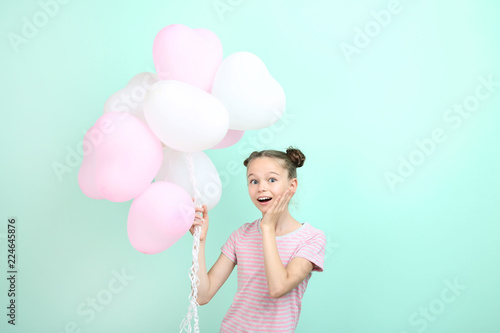 Fotografie, Obraz  Beautiful young girl with balloons on mint background