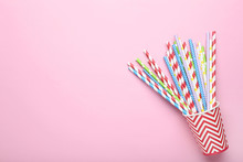 Red Paper Cup With Colorful Straws On Pink Background