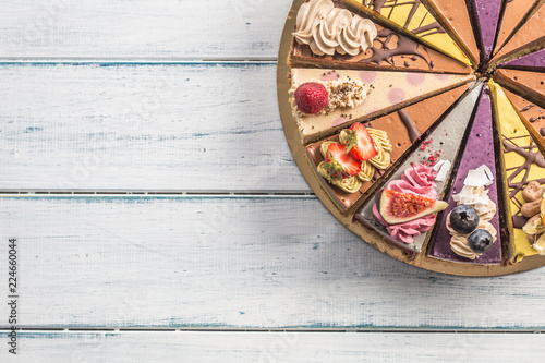 Top of view mini raw cakes on wooden table