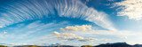 panorama of a gorgeous cloudscape. dynamic high cloud formations on a windy autumn day in mountains