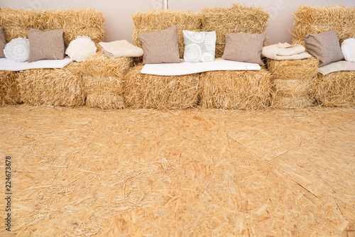 Hay decorations in wedding marquee