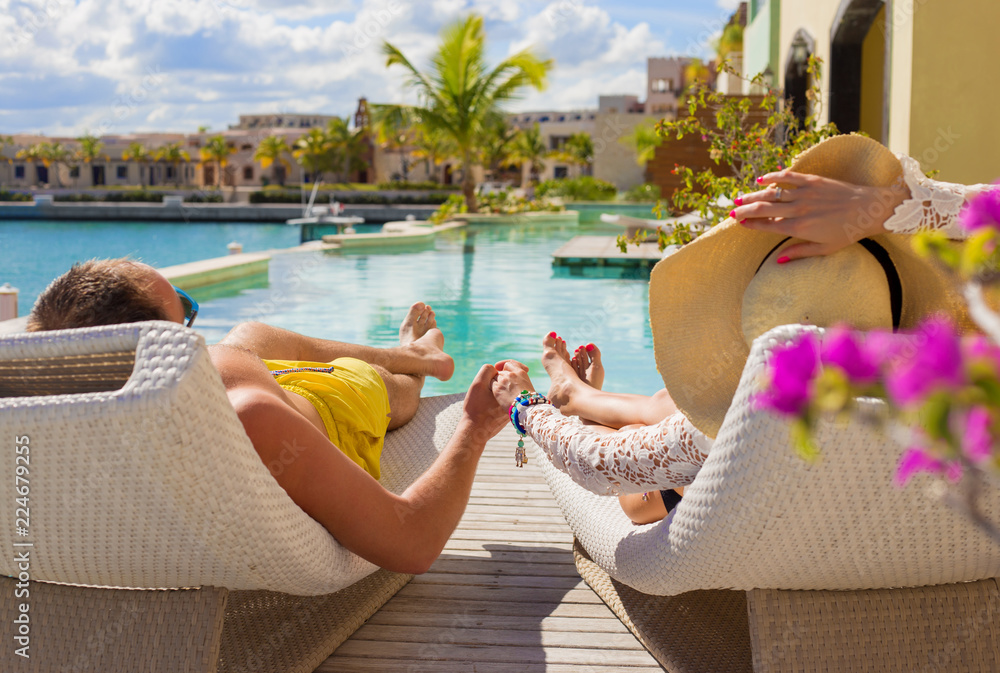 Fototapety, obrazy: Couple on vacation in luxury resort