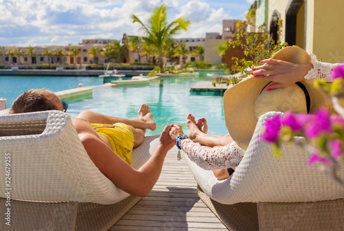 фотографія  Couple on vacation in luxury resort