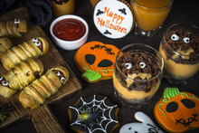Halloween Food Assortment - Sasage Mummies, Pumpkin Dessert, Gin
