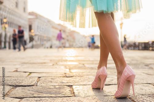 Fotografie, Obraz  Woman walking in high heel shoes in old city