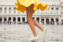Happy Woman In Bright Yellow Skirt And Sneakers