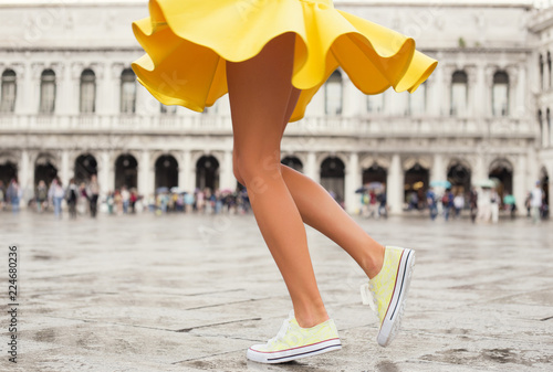 Fotografie, Obraz Happy woman in bright yellow skirt and sneakers