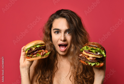 Carta da parati Woman hold two big beef burger sandwich and huge cheeseburger comparing with hun