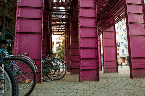Poster Crimson Pink metallic design near the library in Warsaw. Cityscape background