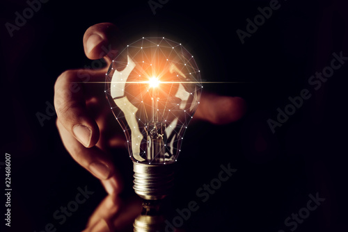 Fotografía  man hand choose glow light bulb creativity business ideas concept black backgrou