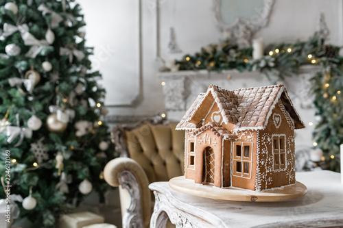 Fotografía  gingerbread house in living room