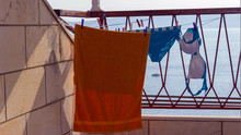 Drying Of Female Swimsuit And Towel On The Balcony