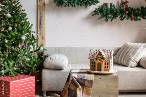 Fotobehang Tuin Xmas in morning living room. Sofa bed In christmas Interior. celebrate the new year and holidays. Christmas tree and gingerbread house