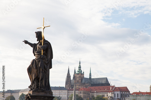 Poster Historisch mon. Statue of John the Baptist, Prague Castle in the background, Czech Republic